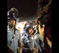Protester is Yelling At Black Police Officer In Ferguson (6 sec clip)